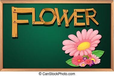 A blackboard with a flower