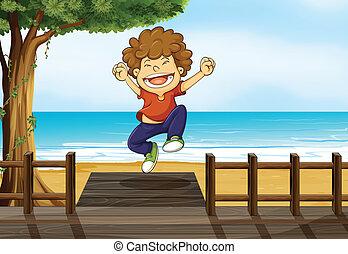 A boy jumping in the bridge