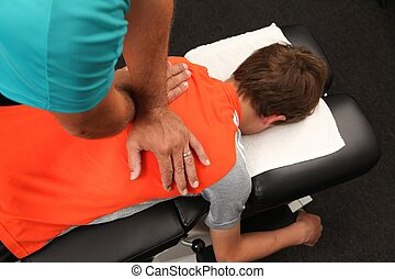 A Chiropractor treating a child