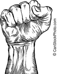 A clenched fist held high in protest.