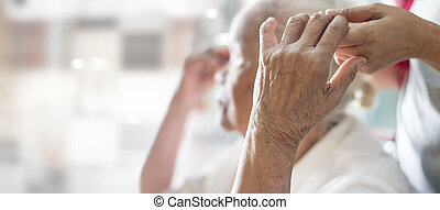 A daughter take care her mother has alzheimer's disease, memory loss due to dementia and disease as a elderly medical health care concept, mother's day.