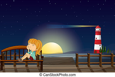 A girl at the wooden bridge