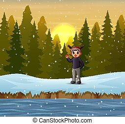 A man waving hand on the forest in winter
