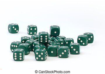 group of green dices randomly scattered on white background