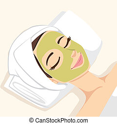 Woman having acne treatment with natural facial green mask to clean face skin