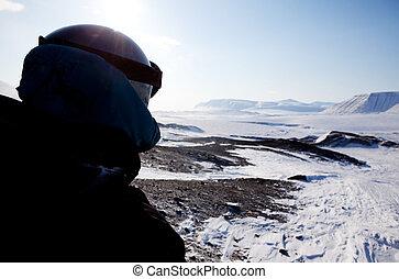 A winter adventure guide on a barren winter landscape