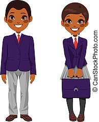 Two cute African American teenage students standing together with uniform and holding suitcase