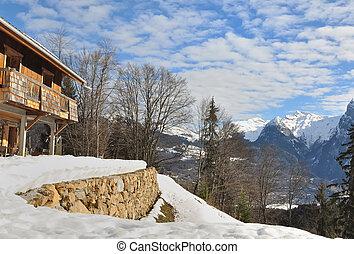 alpine chalet overlooking the snowy mountain