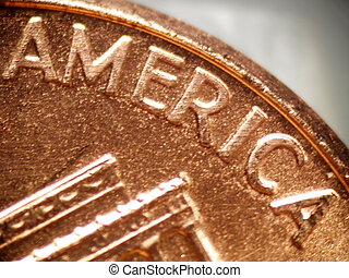 """Macro of a penny focused on the word """"AMERICA"""""""