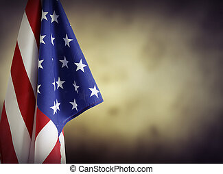 American flag in front of plain background. Advertising space