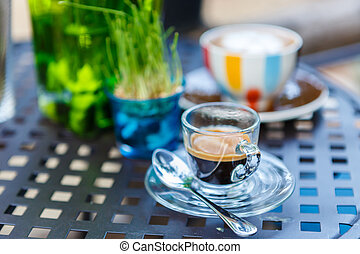 Americano coffee cup on table in cafe