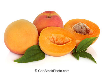 Apricot fruit with leaf sprigs, isolated over white background.
