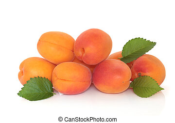 Apricots with leaf sprigs, isolated over white background.