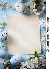art Easter eggs and spring flowers on wooden background