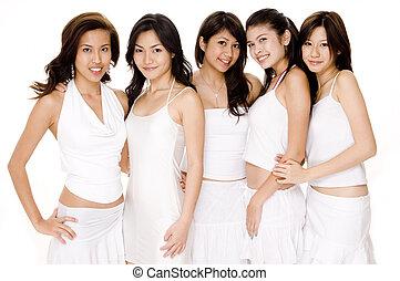 Five beautiful asian women in white on white