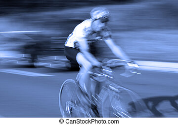 ast bicycle road race cyclist with motion blur