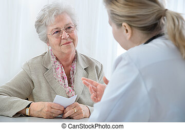 doctor explaining diagnosis to his female patient.