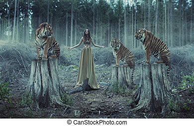 Attractive female trainer with the wild tigers