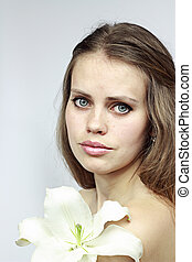 attractive girl with a lily