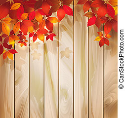Autumn background with leaves on a wood texture