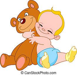 Cheerful baby hugging his teddy bear