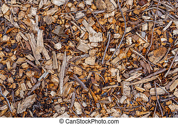 Background texture of natural, tree wood chip mulch ground cover looking head down, brid's eye view.