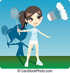 Young brunette woman playing professional badminton indoors