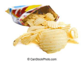 Spilt bag of ripple chips on a white background