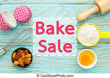 Bake sale with baking ingredients on wood table