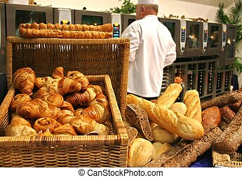 Restaurant kitchen with chef and still life of bread