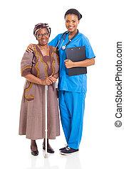 african nurse and senior patient