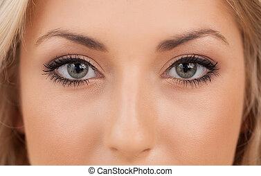 Beautiful eyes. Close-up on woman looking at camera