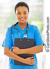 female african medical nurse holding clipboard