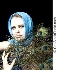 beautiful girl in a scarf and with a feather