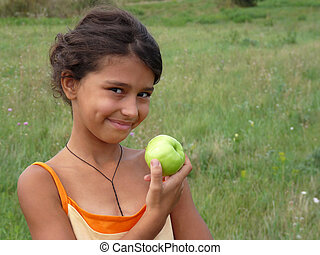 Beautiful girl with a delicious green apple