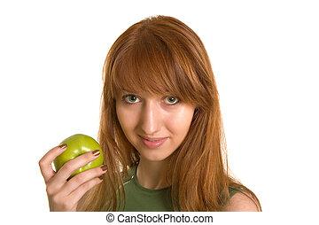 Beautiful girl with green apple