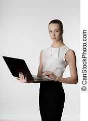 Beautiful girl with laptop in hands