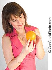 beautiful girl with orange in hands