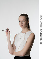 Beautiful girl with pen in hands