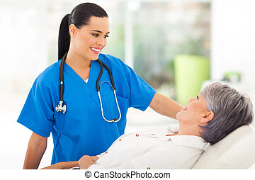 medical nurse talking to senior patient
