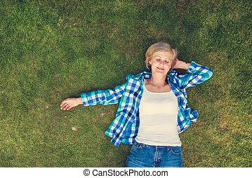 Beautiful senior woman in nature
