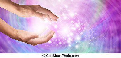 Healer's outstretched hands with sparkling angelic pink and purple colored background