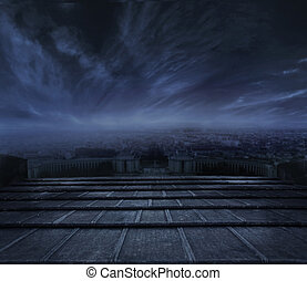 Beautiful view of town at night, Dark clouds over urban background