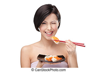 Black-haired girl eating sushi with a chopsticks, isolated