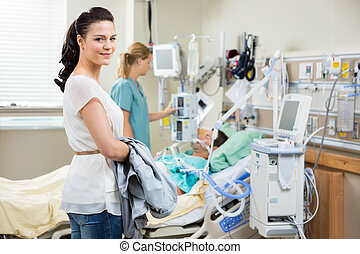 Beautiful Woman With Nurse Examining Patient