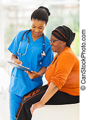 young african nurse explaining medical test result