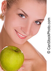 Beautiful young girl with green apple