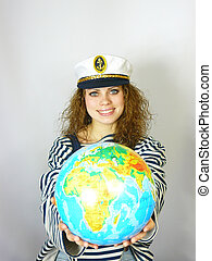young girl with the globe in hands