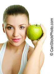 Beautiful young woman with green apple
