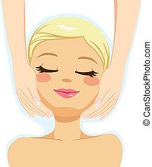 Pretty blonde woman enjoying facial massage beauty therapy